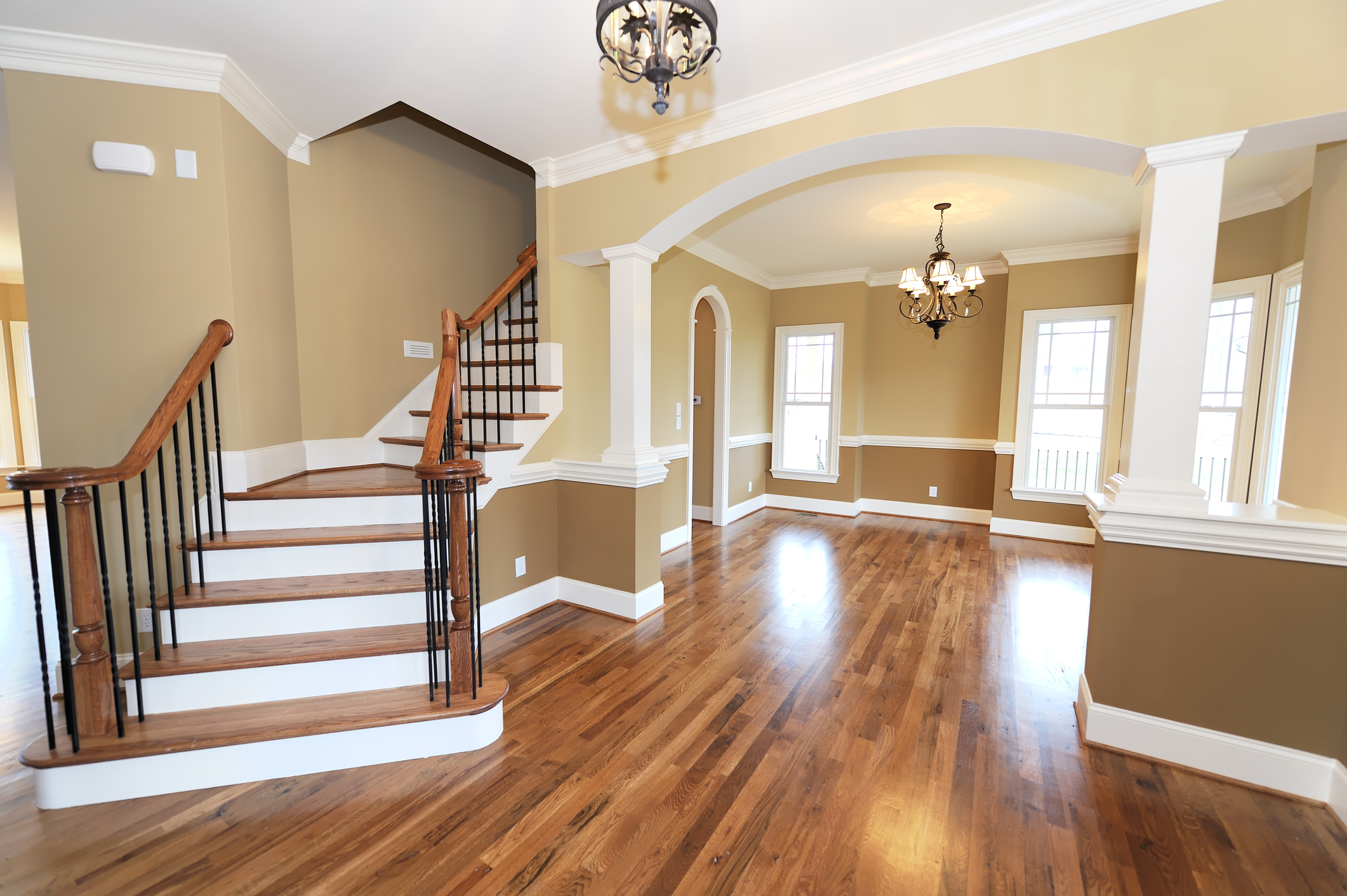 Home interior with hardwood floors and stairs.