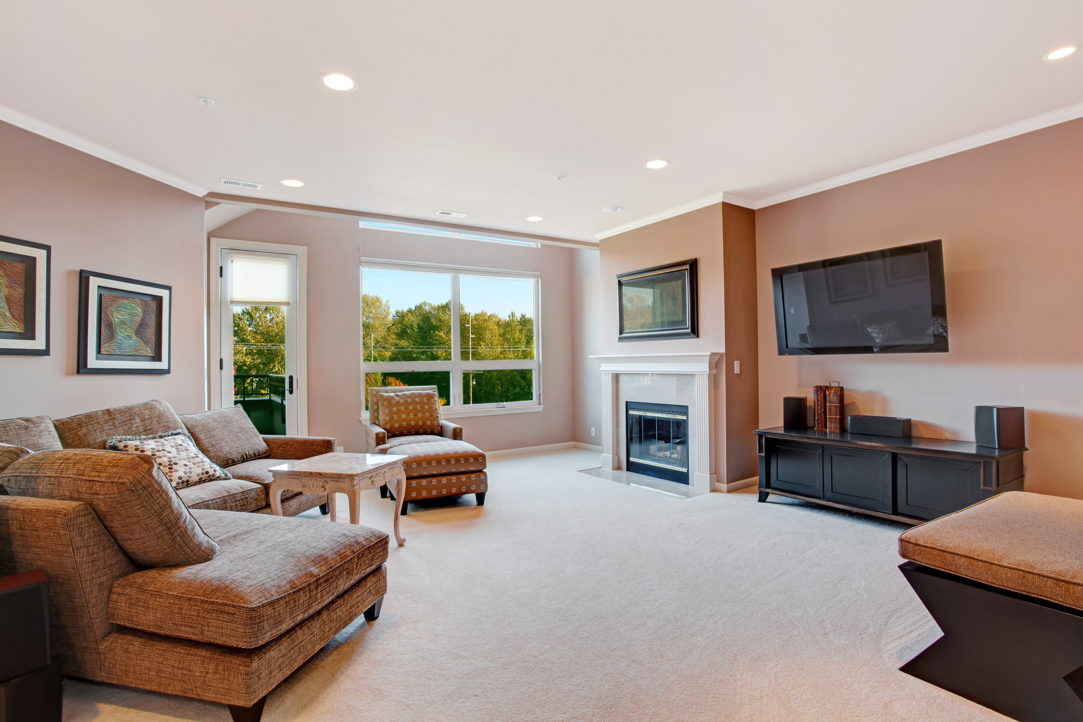 Spacious living room with fireplace and walkout deck.